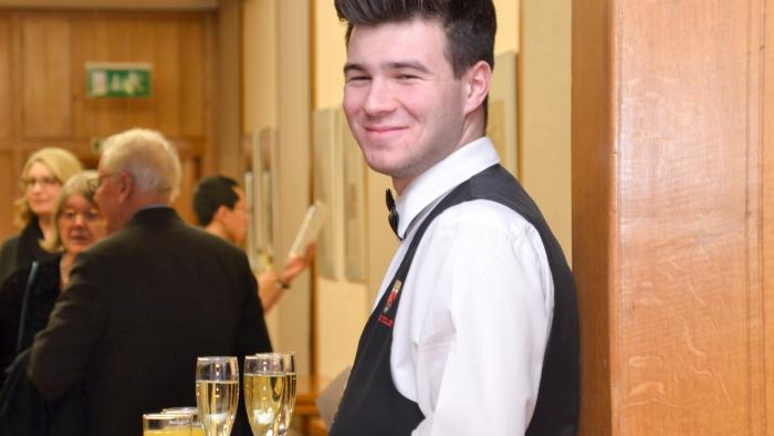 Photo of serving staff with champagne