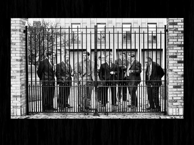 Jack King, Bill Kirkman, Horace Northern and others wait behind the College gates