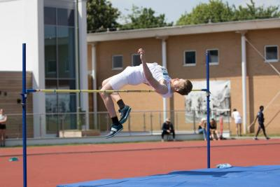 Gunther Klobe high jumping for his blue