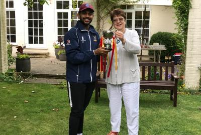 Kaustav receives the President's Cup from the President