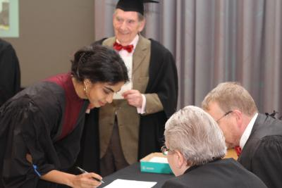 woman signing in at matriculation